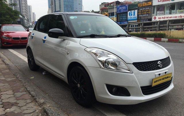 Cần bán xe Suzuki Swift 1.4AT sản xuất 2013, màu trắng, nhập khẩu4