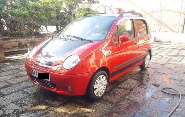Bán ô tô Daewoo Matiz đời 2004, màu đỏ còn mới giá cạnh tranh0