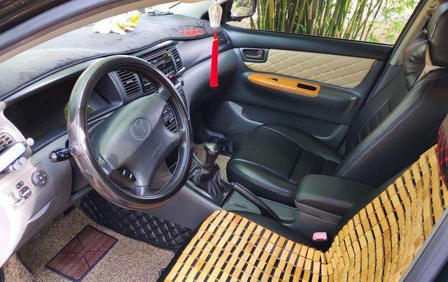 Bán xe Toyota Corolla Altis đời 2004, màu đen còn mới2