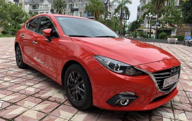 Bán ô tô Mazda 3 1.5AT Hatchback đời 2015, màu đỏ0