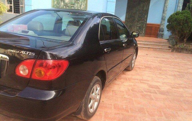 Bán Toyota Corolla Altis đời 2003, màu đen còn mới1