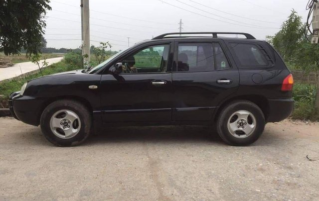 Cần bán gấp Hyundai Santa Fe đời 2007, màu đen0