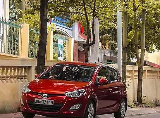 Cần bán Hyundai i20 sản xuất năm 2014, màu đỏ, nhập khẩu nguyên chiếc, chính chủ0