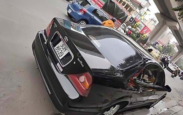 Chính chủ bán Daewoo Magnus năm sản xuất 2006, màu đen, nhập khẩu1