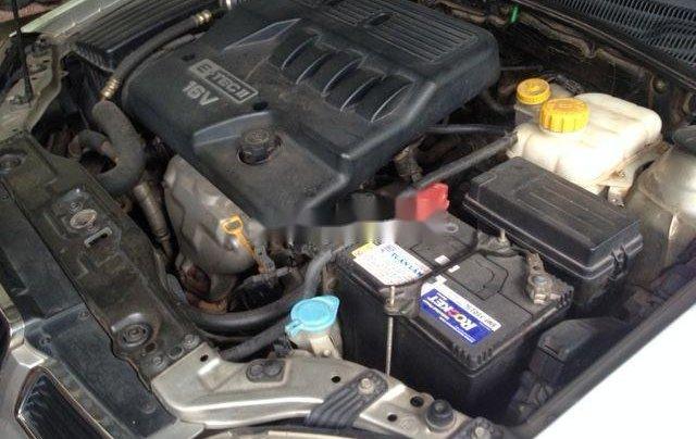 Cần bán gấp xe cũ Daewoo Lacetti đời 2004, màu bạc4