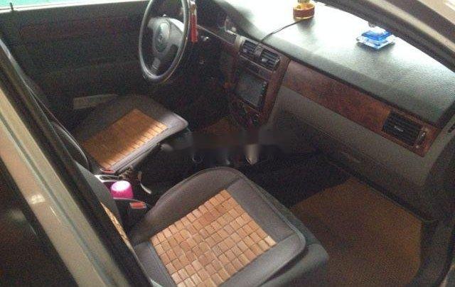 Cần bán gấp xe cũ Daewoo Lacetti đời 2004, màu bạc2