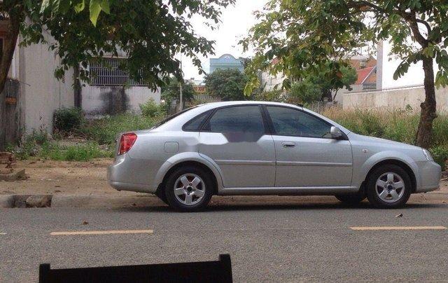 Cần bán gấp xe cũ Daewoo Lacetti đời 2004, màu bạc1