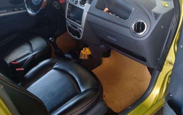 Cần bán xe Chevrolet Spark sản xuất 2009, màu vàng xe gia đình4