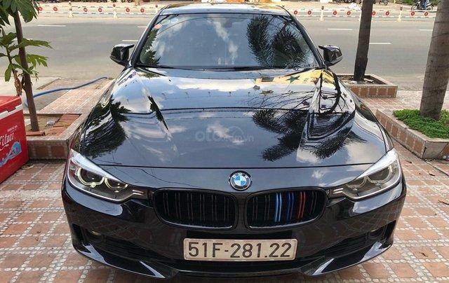 Bán xe BMW 320i 2015, màu đen0