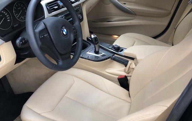 Bán xe BMW 320i 2015, màu đen1