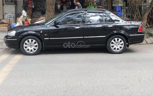 Bán xe Ford Laser năm sản xuất 2004, màu đen, giá rẻ2