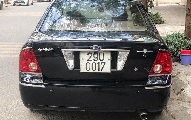 Bán xe Ford Laser năm sản xuất 2004, màu đen, giá rẻ1