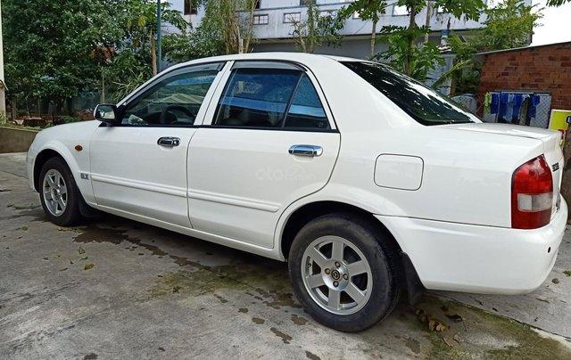 Bán xe Mazda 323 đăng ký 2002, màu trắng ít sử dụng giá tốt 125 triệu đồng 2