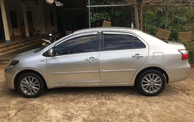 Bán Toyota Vios 1.5E sản xuất 2012, màu bạc xe còn mới nguyên1