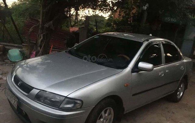 Cần bán lại xe Mazda 323 1.6 MT sản xuất năm 1999, màu bạc xe gia đình, giá 124tr0