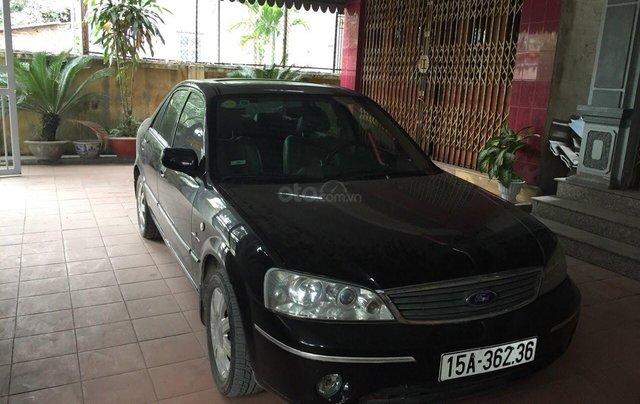 Bán Ford 1.8 năm 2004, màu đen, xe nhập, giá tốt0