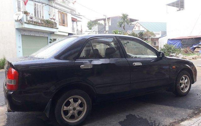 Bán Mazda 323 sản xuất 2004, màu đen còn mới, 139 triệu0