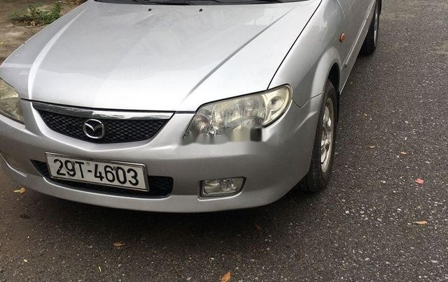 Cần bán gấp Mazda 323 năm 2004, màu bạc còn mới4