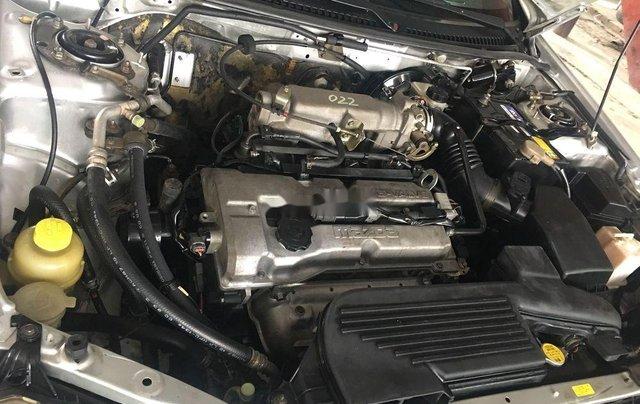 Cần bán gấp Mazda 323 năm 2004, màu bạc còn mới1