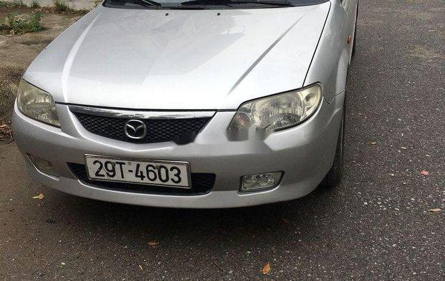 Cần bán gấp Mazda 323 năm 2004, màu bạc còn mới0