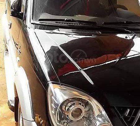 Cần bán gấp Mitsubishi Jolie đời 2005, màu đen xe nguyên bản1
