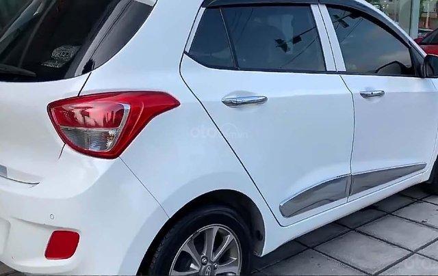 Bán ô tô Hyundai Grand i10 đời 2014, màu trắng, nhập khẩu nguyên chiếc số tự động3