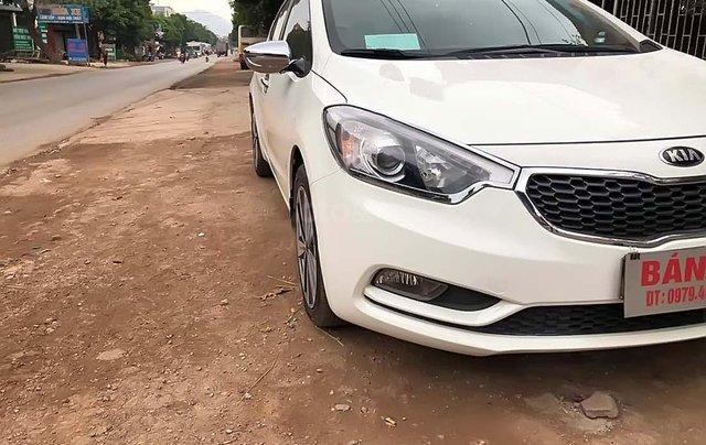 Cần bán xe Kia K3 1.6 MT sản xuất năm 2014, màu trắng, giá 425tr0