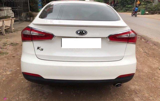 Cần bán xe Kia K3 1.6 MT sản xuất năm 2014, màu trắng, giá 425tr1