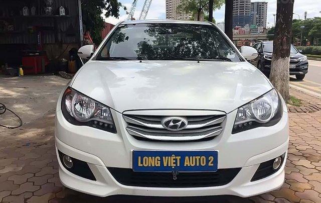 Cần bán lại xe Hyundai Avante 1.6 AT 2012, màu trắng chính chủ0