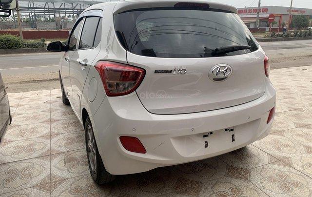Cần bán Hyundai Grand i10 1.0 sản xuất năm 2016, màu trắng, xe nhập4