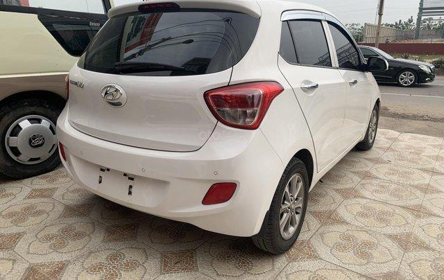 Cần bán Hyundai Grand i10 1.0 sản xuất năm 2016, màu trắng, xe nhập6