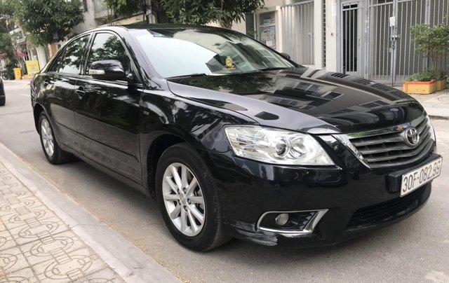 Cần bán xe Toyota Camry 2.4G sản xuất năm 2010, màu đen, 566 triệu5