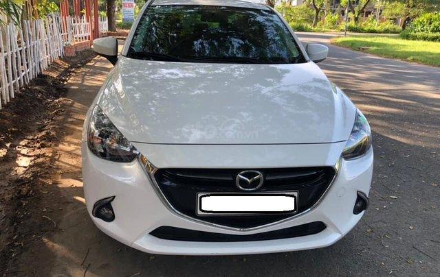 Cần bán xe Mazda 2 năm sản xuất 2017, màu trắng, đi 11.500km, giá chỉ 478tr0