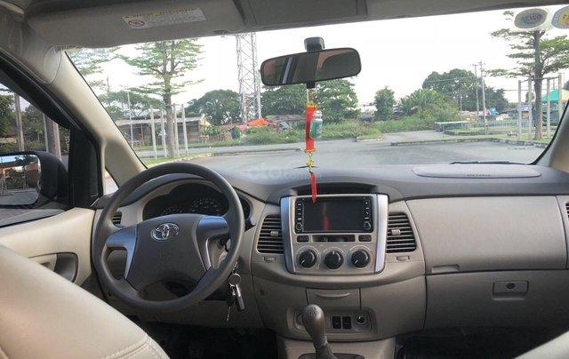 Cần bán xe Toyota Innova 2.0E 2014, xe không dịch vụ biển TP giá 508 triệu5