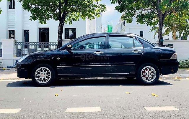 Bán xe Mitsubishi Lancer sản xuất 2005, màu đen, xe nhập1
