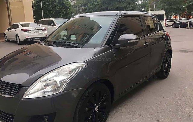 Cần bán Suzuki Swift sản xuất 2014, màu xám, chính chủ 0