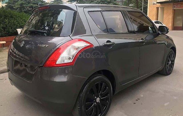 Cần bán Suzuki Swift sản xuất 2014, màu xám, chính chủ 3