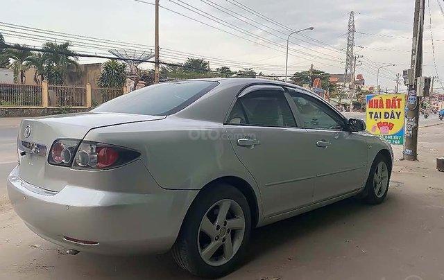 Bán lại xe Mazda 6 đời 2004, màu bạc, số sàn, giá tốt1