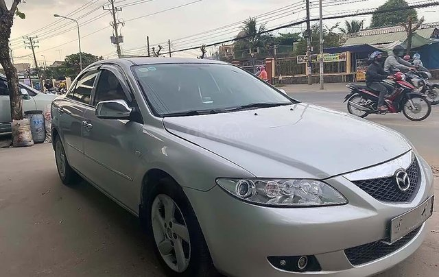 Bán lại xe Mazda 6 đời 2004, màu bạc, số sàn, giá tốt0