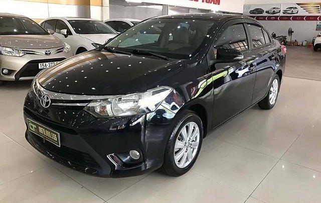 Cần bán xe cũ Toyota Vios 1.5E năm 2014, màu đen0