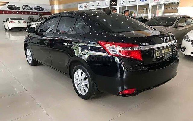 Cần bán xe cũ Toyota Vios 1.5E năm 2014, màu đen1