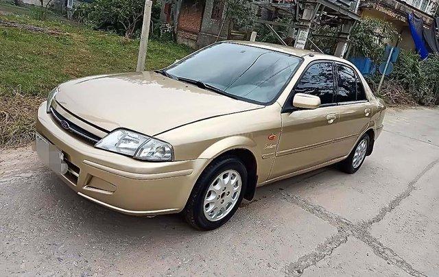 Bán Ford Laser năm 2001, màu vàng, 125tr0