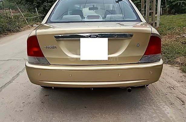 Bán Ford Laser năm 2001, màu vàng, 125tr1