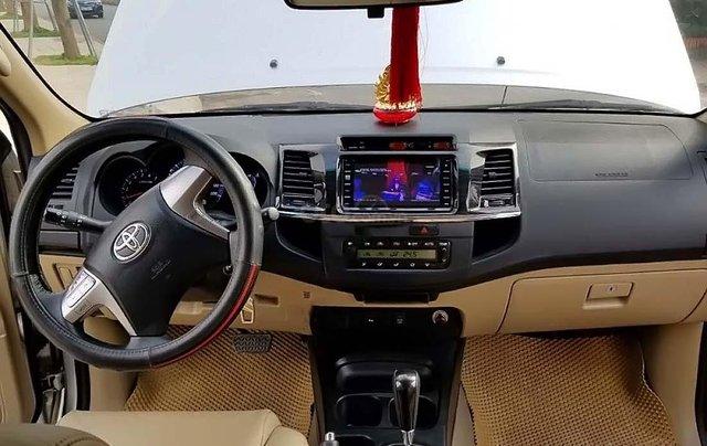 Bán Toyota Fortuner 4x2 AT đời 2015, màu bạc số tự động3