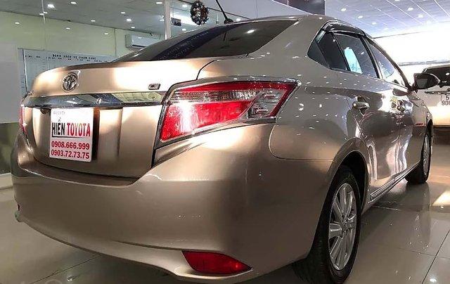 Cần bán xe Toyota Vios 1.5 sản xuất 2014, màu vàng như mới1