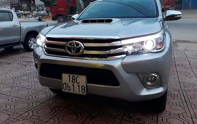 Cần bán Toyota Hilux 3.0G 4x4 AT đời 2015, màu bạc, nhập khẩu 0