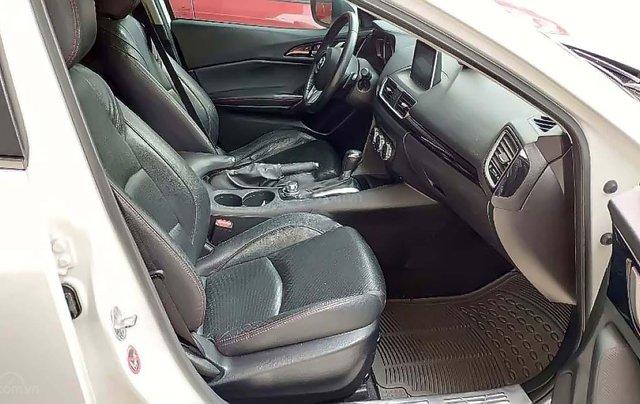 Cần bán Mazda 3 1.5 AT sản xuất năm 2015, màu trắng, số tự động1