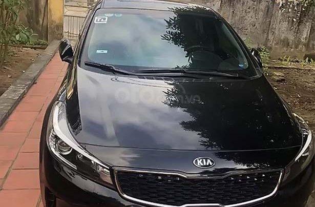 Cần bán xe cũ Kia Cerato AT đời 2016, màu đen0