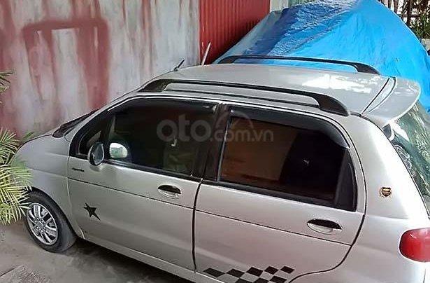 Cần bán gấp Daewoo Matiz 2005, màu bạc xe gia đình0