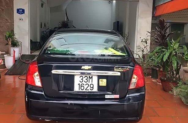 Cần bán lại xe Daewoo Lacetti MT sản xuất 2005, màu đen số sàn1